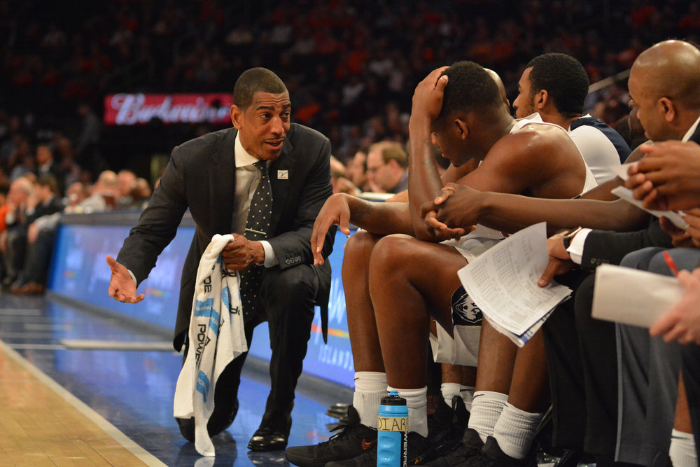 Head coach Kevin Ollie discusses strategy with his players during the Huskies 72-63 loss to longtime rival Syracuse on Tuesday, Dec. 6, 2017 at Madison Square Garden in New York City. (Olivia Stenger/The Daily Campus)