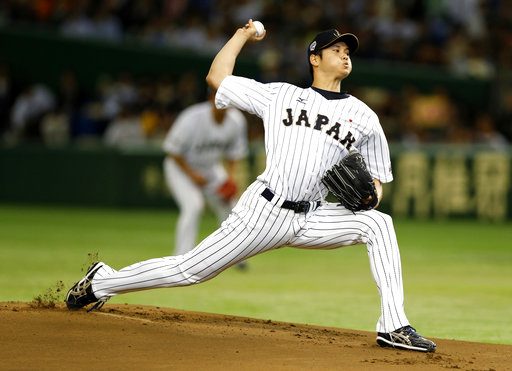In this Nov. 19, 2015, file photo, Japan's starter Shohei Otani pitches against South Korea during the first inning of their semifinal game at the Premier12 world baseball tournament at Tokyo Dome in Tokyo. (AP Photo/Toru Takahashi, File)