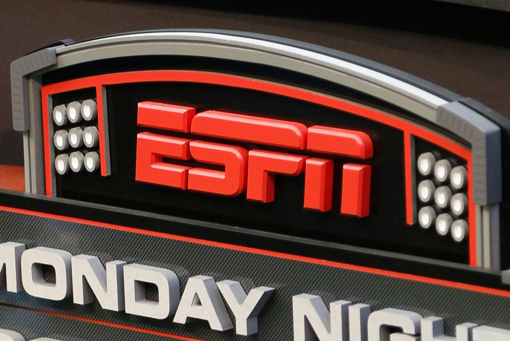 FILE - This Sept. 16, 2013, file photo shows the ESPN logo prior to an NFL football game between the Cincinnati Bengals and the Pittsburgh Steelers, in Cincinnati.