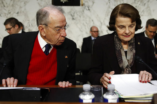 "Senate Judiciary Committee Chairman Chuck Grassley, R-Iowa, and ranking member Sen. Dianne Feinstein, D-Calif., arrive for a Senate Judiciary Committee hearing on Capitol Hill in Washington, Wednesday, Dec. 6, 2017, entitled: ""Firearm Accessory Regulation and Enforcing Federal and State Reporting to the National Instant Criminal Background Check System (NICS)."" (AP Photo/Carolyn Kaster)"
