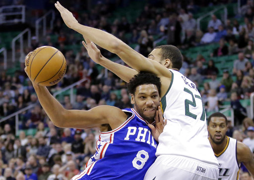 FILE - In this Dec. 29, 2016, file photo, Philadelphia 76ers center Jahlil Okafor (8) drives to the basket as Utah Jazz center Rudy Gobert (27) defends in the first half during an NBA basketball game in Salt Lake City.(AP Photo/Rick Bowmer, File)