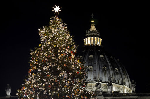 A 21 meters (69 feet) high Christmas tree coming from Poland is backdropped by the dome of St. Peter's Basilica, at the Vatican, Thursday, Dec. 7, 2017. (AP Photo/Andrew Medichini)