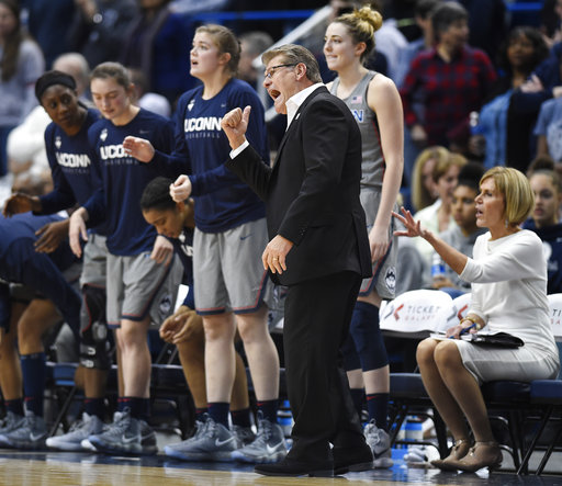Connecticut head coach Geno Auriemma, third from right, calls to his players during the second half an NCAA college basketball game against Notre Dame, Sunday, Dec. 3, 2017, in Hartford, Conn. (AP Photo/Jessica Hill)
