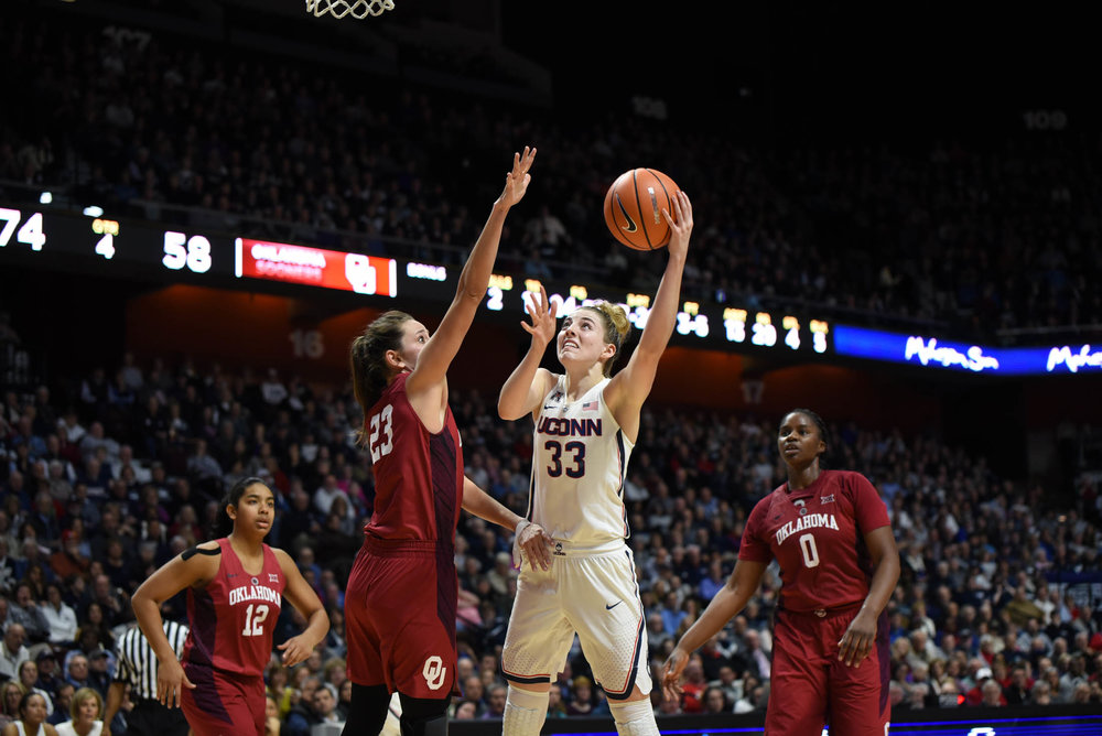 Katie Lou Samuelson goes up for a shot against a defender. Samuelson finishes the game with 19 points to help the Huskies defeat the Sooners 88-64. (Charlotte Lao/The Daily Campus)
