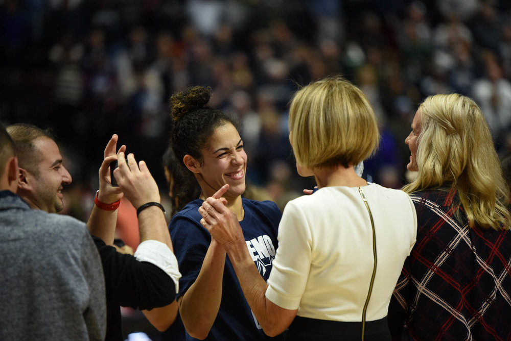 Kia Nurse congratulates Chris Dailey on her accomplishment. (Charlotte Lao/The Daily Campus)