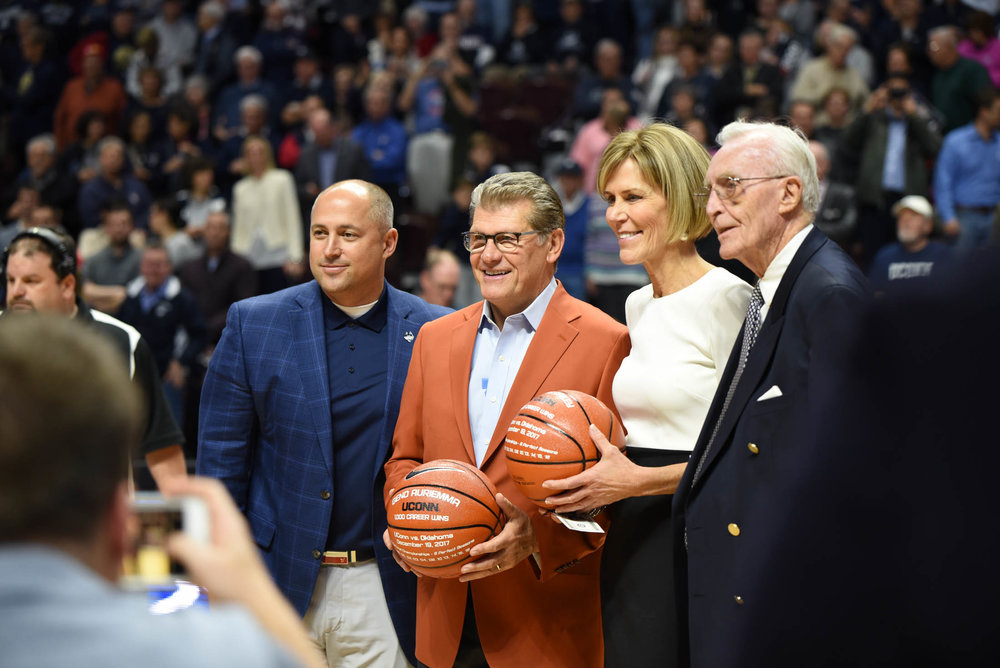 Geno Auriemma and Chris Dailey receive basketballs for their achievement. (Charlotte Lao/The Daily Campus)