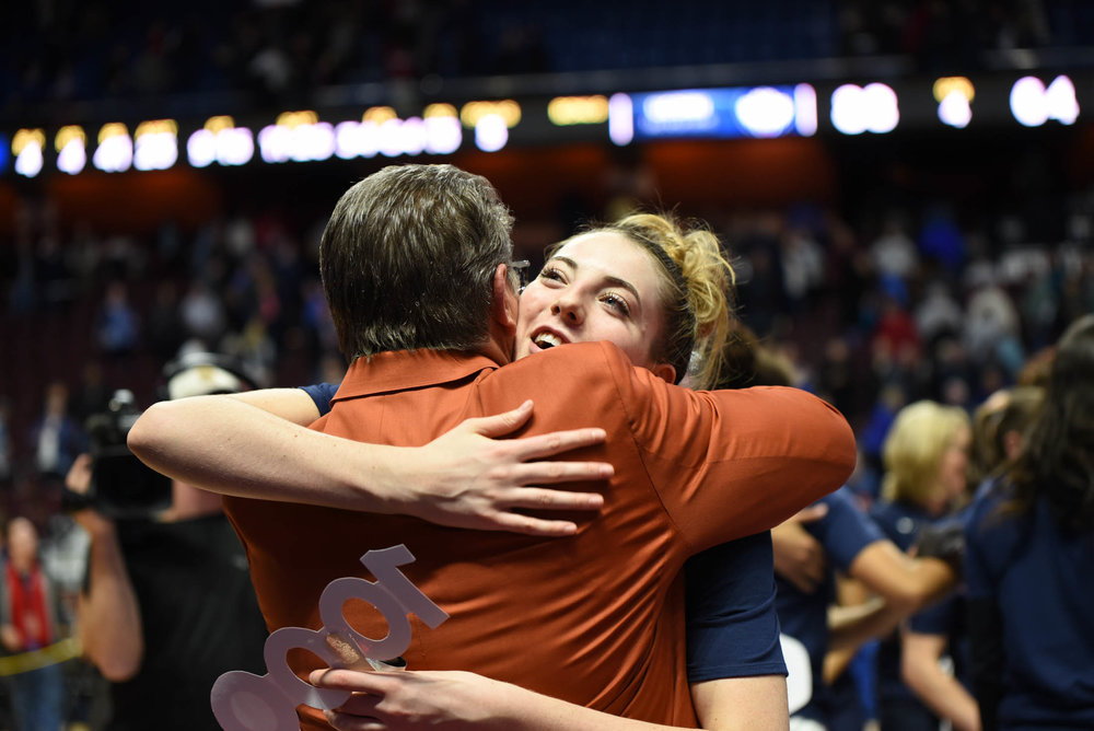 Katie Lou Samuelson congratulates her coach for his accomplishment. (Charlotte Lao/The Daily Campus)