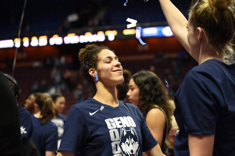 UConn guard Katie Lou Samuelson throws confetti on Kia Nurse during a celebration of head coach Geno Auriemma's 1,000th win. The Huskies will take on Duquesne in Toronto, Ontario for Nurse's senior homecoming game. (Charlotte Lao, Associate Photo Editor/The Daily Campus)