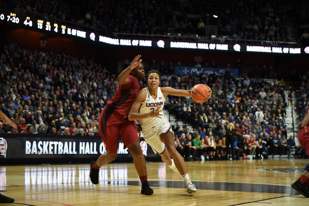 UConn forward Napheesa Collier drives toward the hoop in the Huskies' 88-64 win over the Oklahoma Sooners Tuesday, Dec. 19 at Mohegan Sun Arena in Uncasville, Connecticut. (Charlotte Lao, Associate Photo Editor/The Daily Campus)