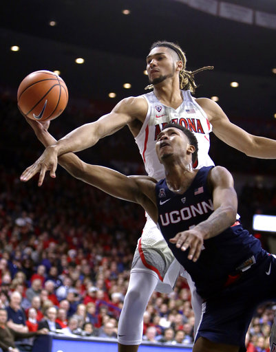Jalen Adams fights for the ball in UConn's loss to Arizona on Thursday, Dec. 21. Adams led all Husky scorers in their 89-64 loss to Auburn on Saturday, Dec. 23.  (AP Photo/Rick Scuteri)