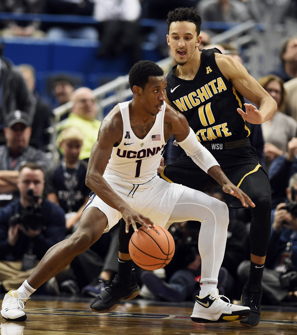Christian Vital pushes past Wichita State's Landry Shamet in UConn's 72-62 loss, Saturday, Dec. 30, 2017 at the XL Center in Hartford. (AP Photo/Jessica Hill)