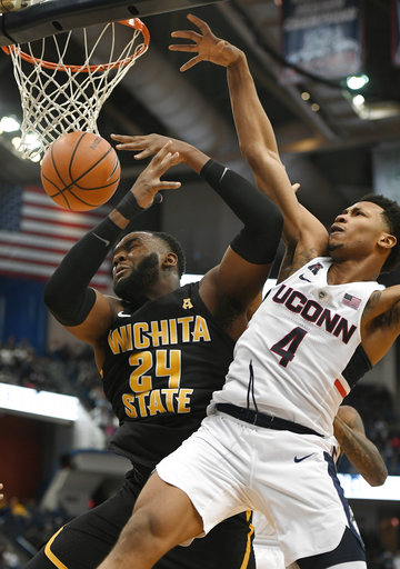 Connecticut's Jalen Adams stops a shot attempt by Wichita State's Shaquille Morris in UConn's 72-62 loss to the Shockers at the XL Center on Saturday, Dec. 30. (AP Photo/Jessica Hill)