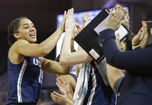 Connecticut's Gabby Williams (15) high-fives the bench following a play against East Carolina during the second half of an NCAA college basketball game in Greenville, N.C., Wednesday, Jan. 3, 2018. Connecticut won 96-35. (AP Photo/Gerry Broome)