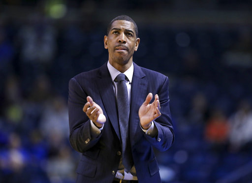 Connecticut coach Kevin Ollie claps as he walks down the sideline during the team's NCAA college basketball game against Tulsa in Tulsa, Okla., Wednesday, Jan. 3, 2018. (Jessie Wardarski/Tulsa World/Tulsa World via AP)