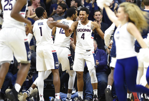 Connecticut's Jalen Adams, right, celebrates with teammate Christian Vital, left, after hitting a three point basket at the buzzer for the half during the first half an NCAA college basketball game against Central Florida, Wednesday, Jan. 10, 2018, in Storrs, Conn. (AP Photo/Jessica Hill)