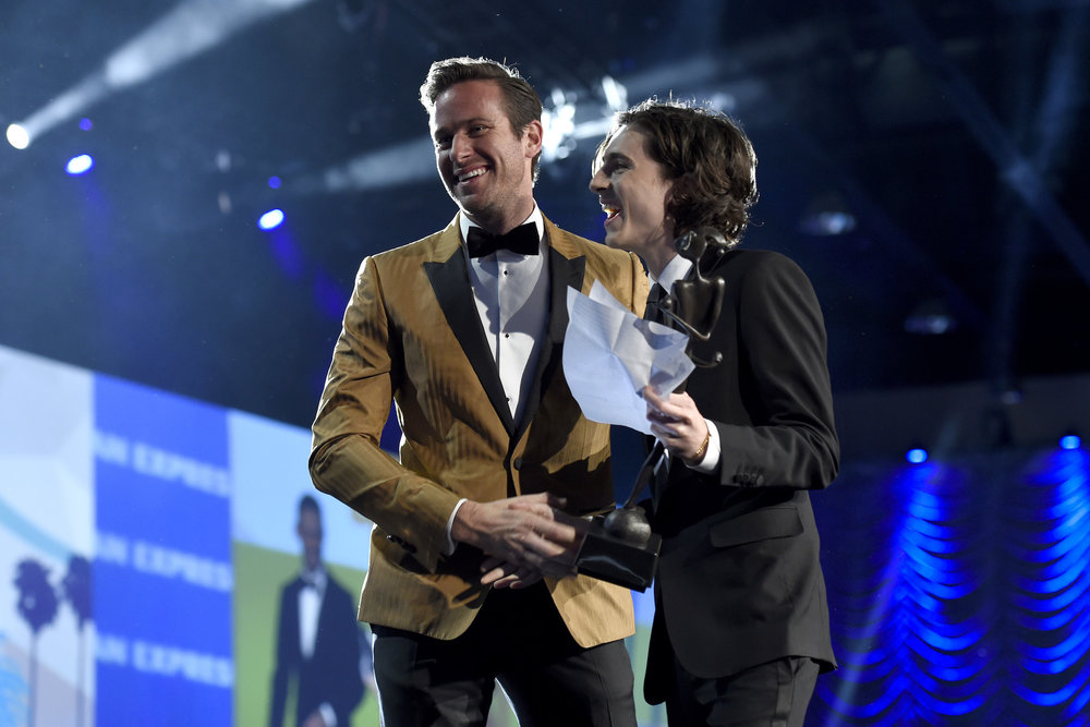 "Armie Hammer, left, presents the rising star award-actor to Timothee Chalamet for ""Call Me by Your Name"" at the 29th annual Palm Springs International Film Festival on Tuesday, Jan. 2, 2018, in Palm Springs, Calif. (Photo by Chris Pizzello/Invision/AP)"