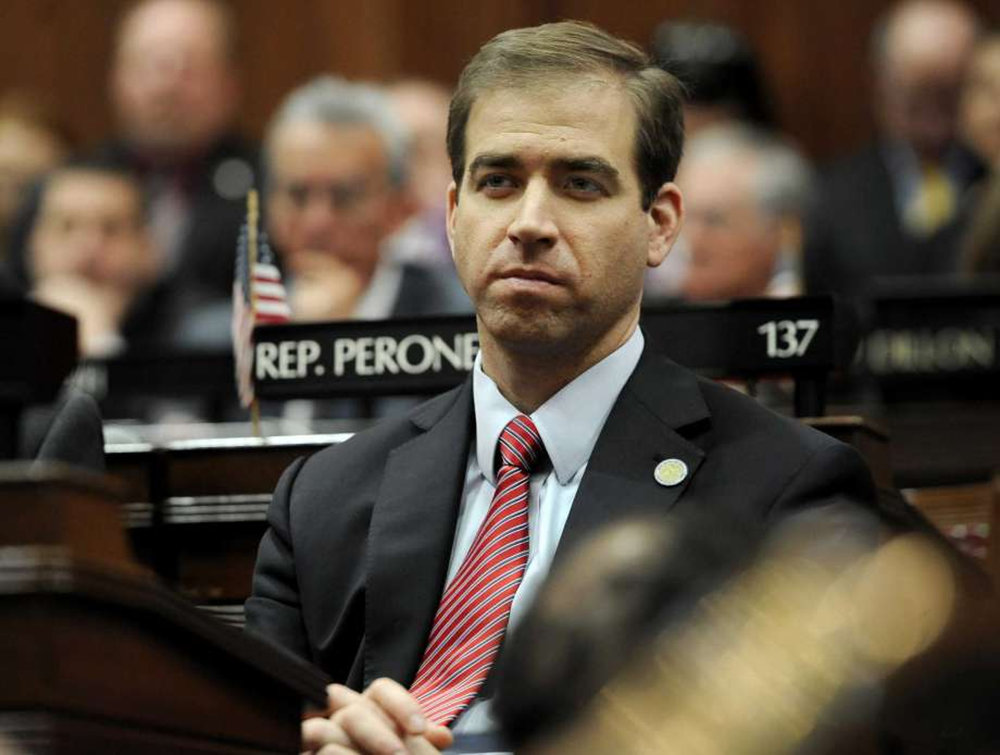 Hartford Mayor Luke Bronin listens to Connecticut Gov. Dannel P. Malloy budget address at the State Capitol, Wednesday, Feb. 3, 2016, in Hartford, Conn. (Jessica Hill/Associated Press)