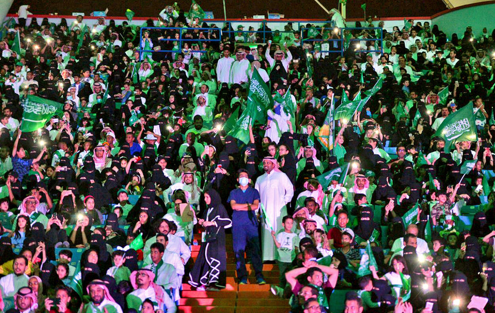 In this Sept. 23, 2017 file photo released by Saudi Press Agency, SPA, Saudi men and women attend national day ceremonies at the King Fahd stadium in Riyadh, Saudi Arabia. Saudi women will for the first time be allowed to enter a sports stadium on Friday, Jan. 12, 2018. The move is Saudi Arabia's first social reform planned for this year granting women greater rights.  (Saudi Press Agency/AP)