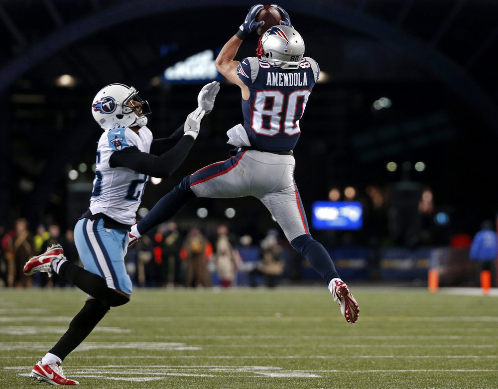 New England Patriots wide receiver Danny Amendola (80) catches a pass in front of Tennessee Titans cornerback Logan Ryan (26) during the second half of an NFL divisional playoff football game, Saturday, Jan. 13, 2018, in Foxborough, Mass. (Michael Dwyer/AP)