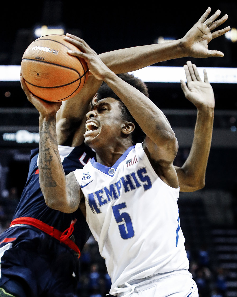 Memphis guard Kareem Brewton Jr., right, is fouled by a UConn player while driving the lane during the first half of an NCAA college basketball game in Memphis, Tenn., Tuesday, Jan. 16, 2018. (Mark Weber/AP)