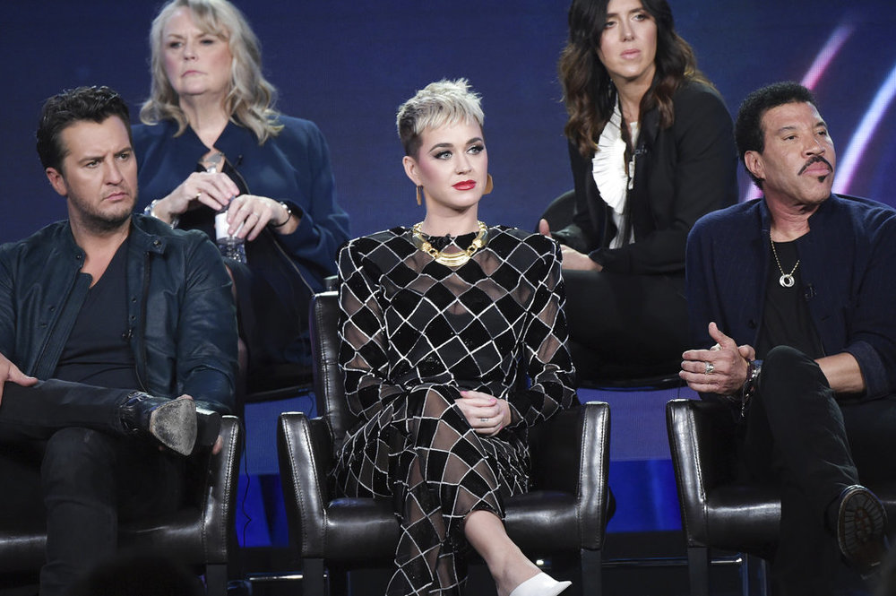 "Luke Bryan, from left, Katy Perry and Lionel Richie participate in the ""American Idol"" panel during the Disney/ABC Television Critics Association Winter Press Tour on Monday, Jan. 8, 2018, in Pasadena, Calif. (Photo by Richard Shotwell/Invision/AP)"
