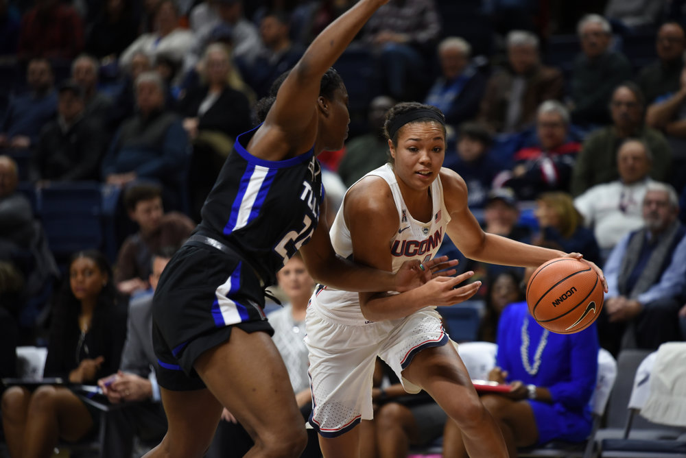 Napheesa Collier fights off a Tulsa defender during the Huskies 78-60 win over the Golden Hurricane on Thursday, Jan. 18, 2018 at Gampel Pavilion. Collier put up 19 points, the second highest on the team. (Charlotte Lao/The Daily Campus)