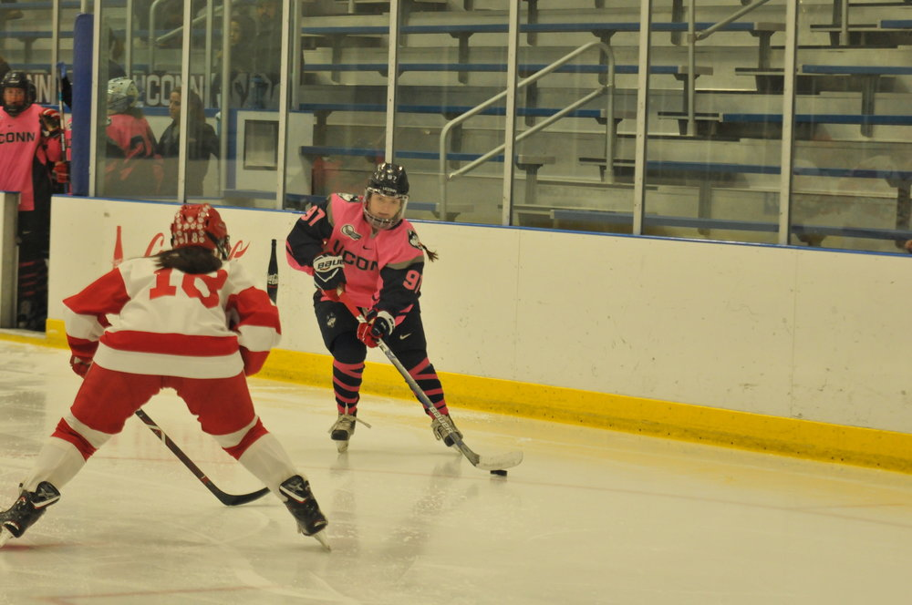 Forward Catherine Crawley moves the puck against the Terriers (Jon Sammis/The Daily Campus)