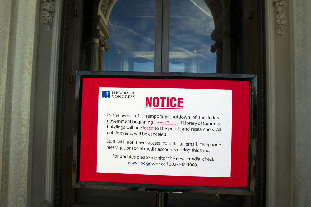 Library of Congress posts a sign letting people know its' closed due to the shut down of the government on Saturday, Jan. 20, 2018, at the Capitol in Washington. The federal government shut down at the stroke of midnight Friday, halting all but the most essential operations. (Jose Luis Magana/AP)