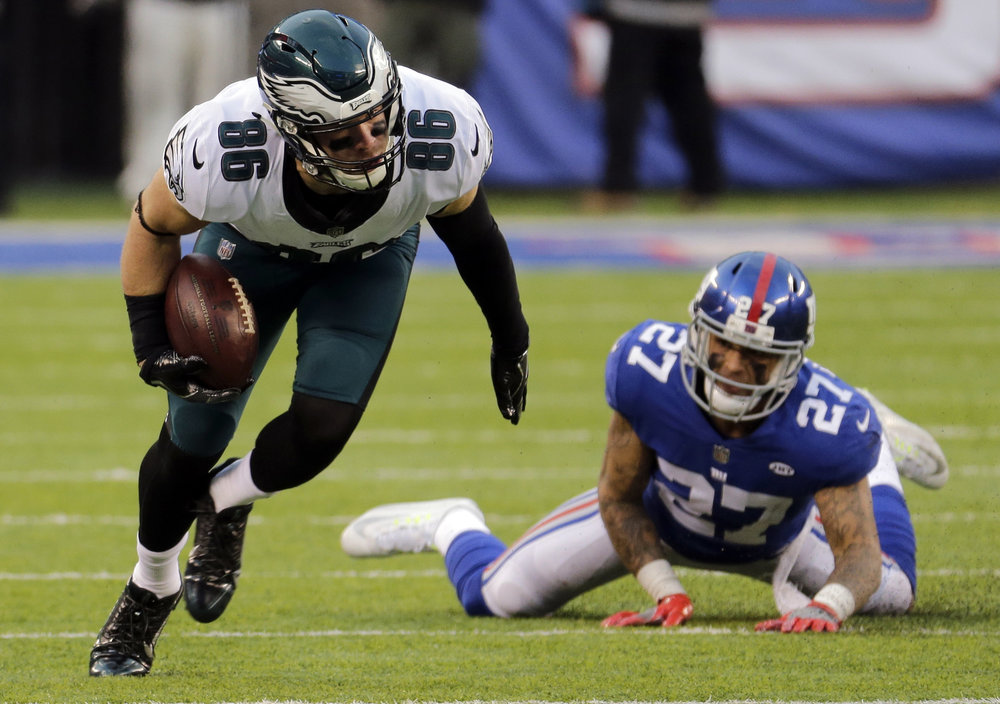 FILE - In this Dec. 17, 2017, file photo, Philadelphia Eagles tight end Zach Ertz (86) avoids the tackle attempt of New York Giants free safety Darian Thompson (27) during the second half of an NFL football game in East Rutherford, N.J. The Philadelphia Eagles host the Minnesota Vikings in the NFC championship on Sunday. (AP Photo/Seth Wenig, File)