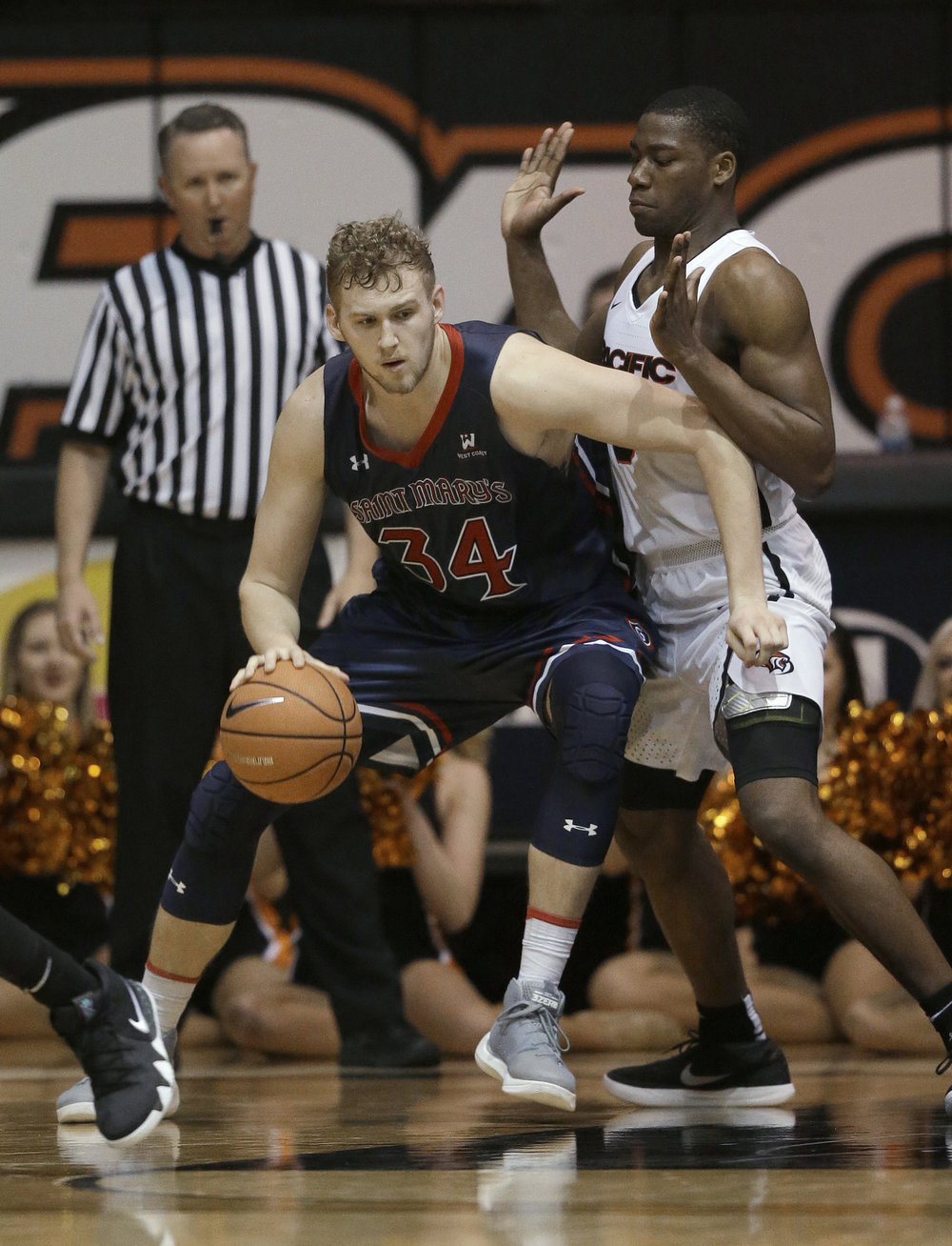 Saint Mary's center Jock Landale, left, goes to the basket against Pacific forward Anthony Townes during the second half of an NCAA college basketball game Saturday, Jan. 20, 2018, in Stockton, Calif. (Rich Pedroncelli/AP)