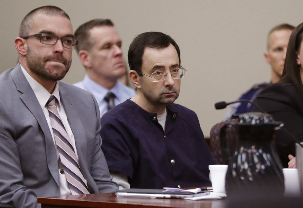 Larry Nassar sits with attorney Matt Newburg during his sentencing hearing Wednesday, Jan. 24, 2018, in Lansing, Mich. (AP Photo/Carlos Osorio)