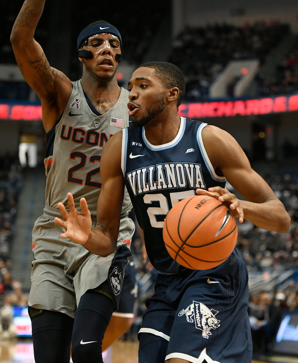 UConn's Terry Larrier, left, guards Villanova's Mikal Bridges during the second half of an NCAA college basketball game, Saturday, Jan. 20, 2018, in Hartford, Conn. (AP Photo/Jessica Hill)