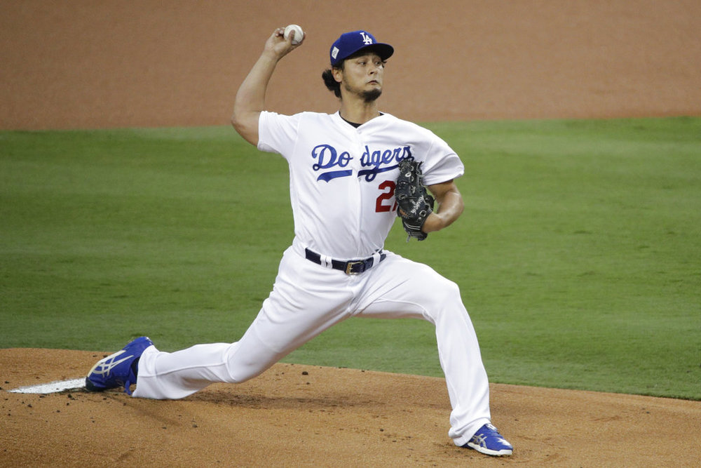 In this Nov. 1, 2017, file photo, Los Angeles Dodgers starting pitcher Yu Darvish, of Japan, throws against the Houston Astros during the first inning of Game 7 of baseball's World Series in Los Angeles. A person with direct knowledge of the discussions says the Chicago Cubs are having active talks with free-agent Darvish. (AP Photo/Jae C. Hong, File)