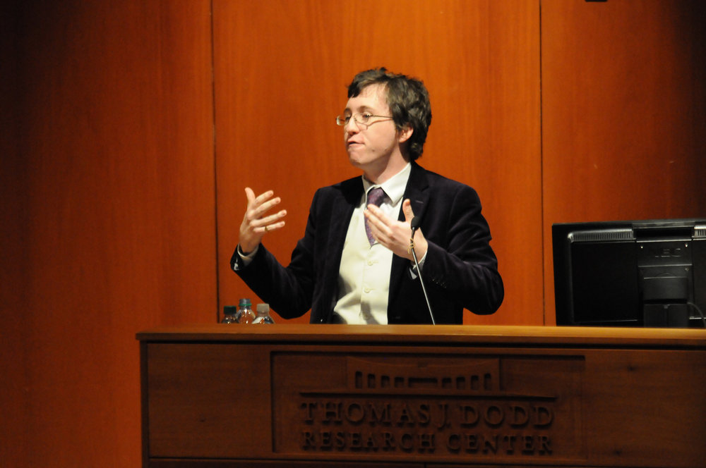Nathan Robinson speaks at the Dodd center on Wednesday, Jan. 24, in response to another speaker on campus, Ben Shapiro, seeking to disarm his opponent. (Jon Sammis/The Daily Campus)
