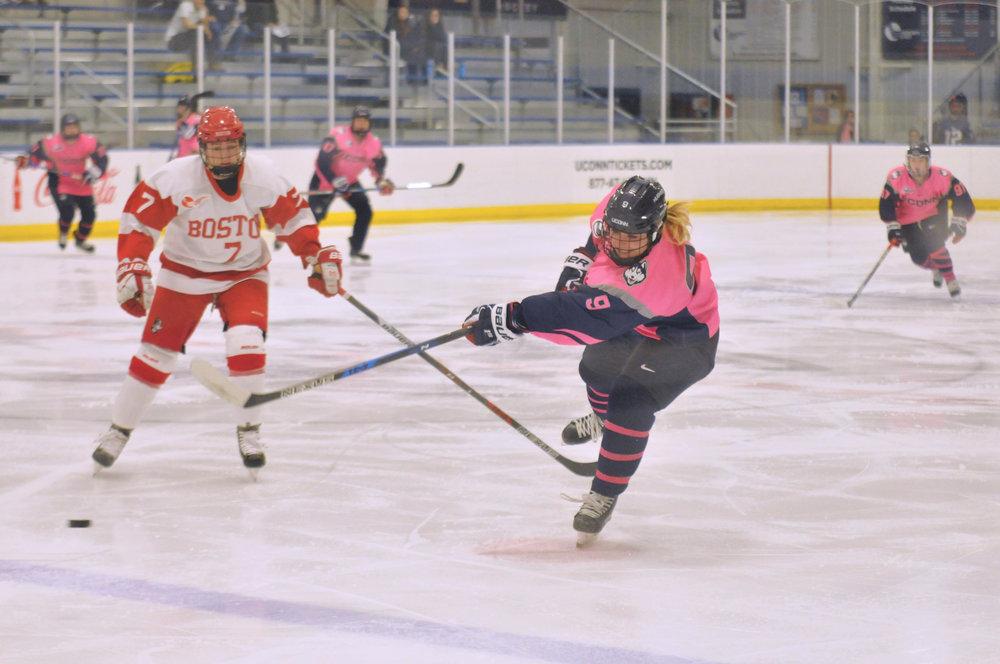 Freshman forward Natalie Snodgrass (9) fires off a shot during the Huskies 2-2 tie against the BU Terriers in Frietas Ice Forum on Jan. 21, 2017. (Jon Sammis/The Daily Campus)