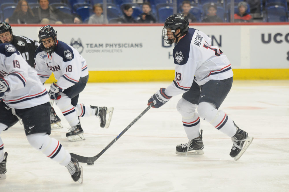 Junior defenseman Joseph Masonius (13) drives the puck forward during the Huskies 3-1 victory over the Providence Friars on Jan. 18, 2017 at the XL Center in Hartford, CT. (Eric Wang/The Daily Campus)