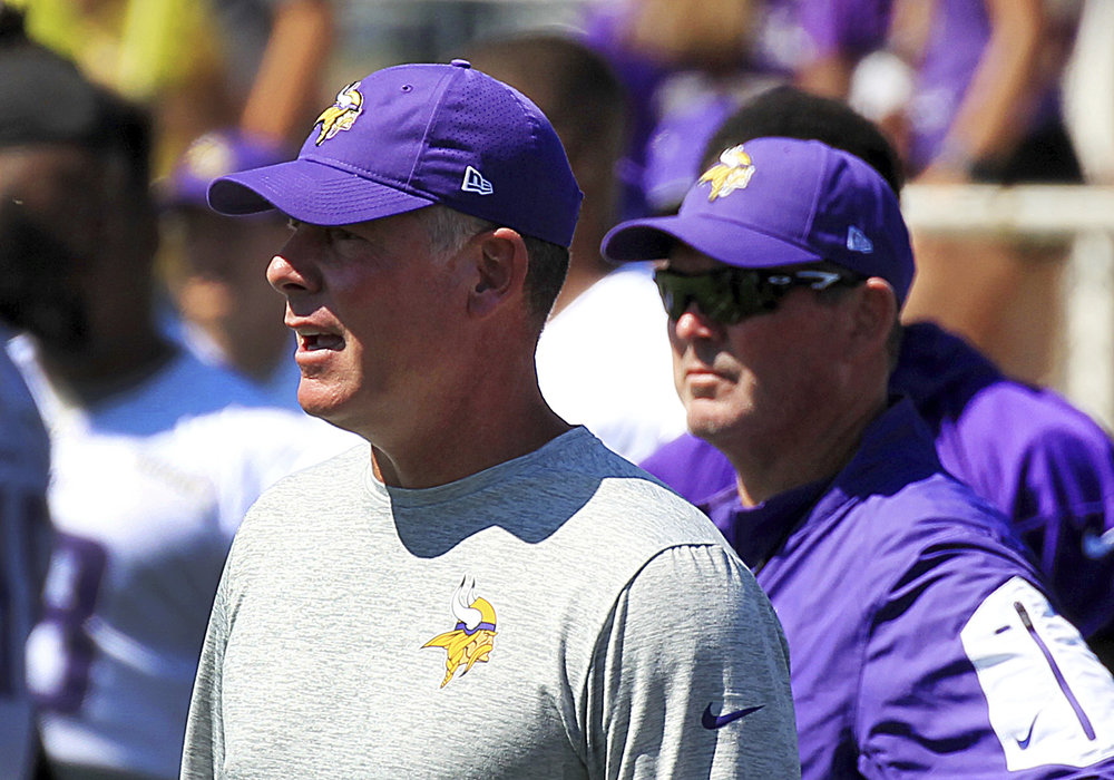 FILe - In this July 27, 2017, file photo, Minnesota Vikings offensive coordinator Pat Shurmur, left, and head coach Mike Zimmer watch practice during NFL football training camp in Mankato, Minn. Vikings offensive coordinator Pat Shurmur has been hired as the New York Giants head coach. The Giants announced the hiring late Monday afternoon, Jan. 22, 2018, less than 24 hours after Shurmur and the Vikings were beaten by the Philadelphia Eagles in the NFC title game. (AP Photo/Andy Clayton-King, File)