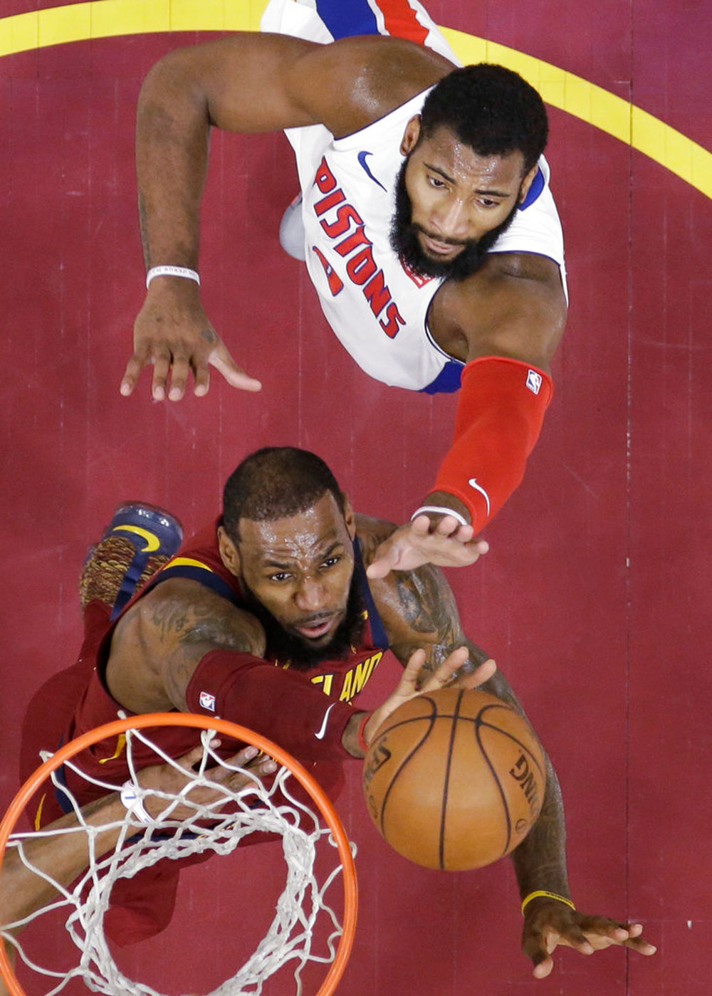 Cleveland Cavaliers' LeBron James, left, drives to the basket against Detroit Pistons' Andre Drummond in the first half of an NBA basketball game, Sunday, Jan. 28, 2018, in Cleveland. The Cavaliers won 121-104. (AP Photo/Tony Dejak)