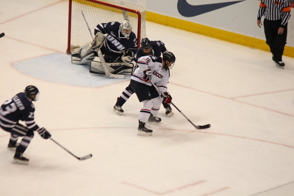Forward Karl El-Mir maneuevers the puck in UNH territory during Friday's win (Ryan Murace/The Daily Campus)