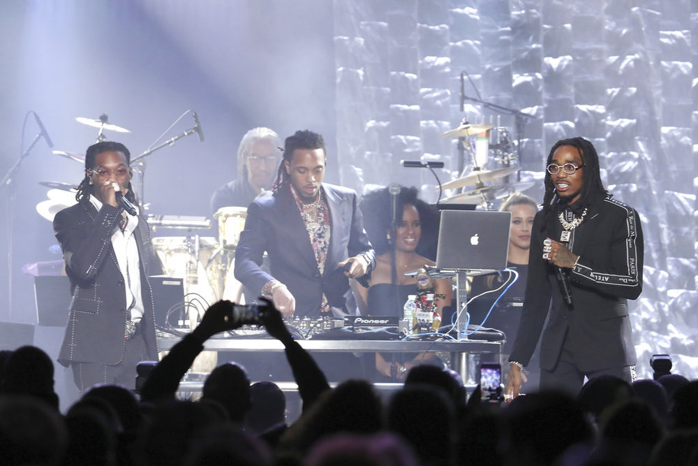 Migos perform onstage at the 2018 Pre-Grammy Gala And Salute To Industry Icons at the Sheraton New York Times Square Hotel on Saturday, Jan. 27, 2018, in New York. (Photo by Michael Zorn/Invision/AP)