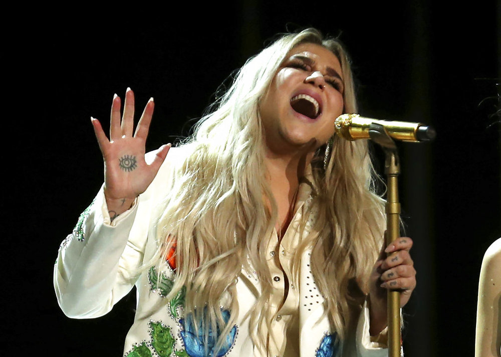 "Kesha performs ""Praying"" at the 60th annual Grammy Awards at Madison Square Garden on Sunday, Jan. 28, 2018, in New York. (Photo by Matt Sayles/Invision/AP)"