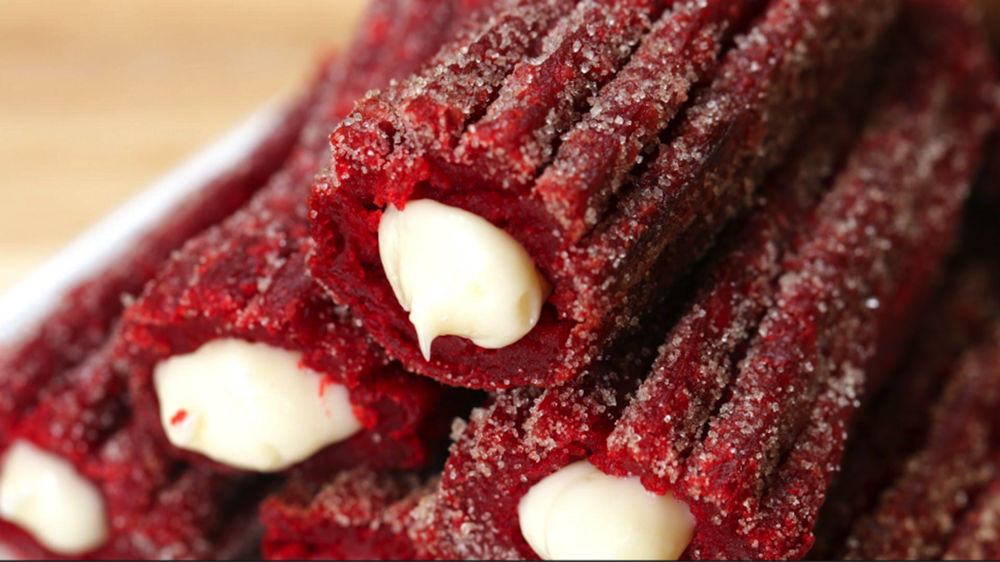 This week on Melissa's Menu: red velvet churros. The dessert combines two classic recipes that savors the cinnamon-sugary crust of churros and the rich flavors of red velvet and cream cheese. (Screenshot courtesy of Tasty.com)