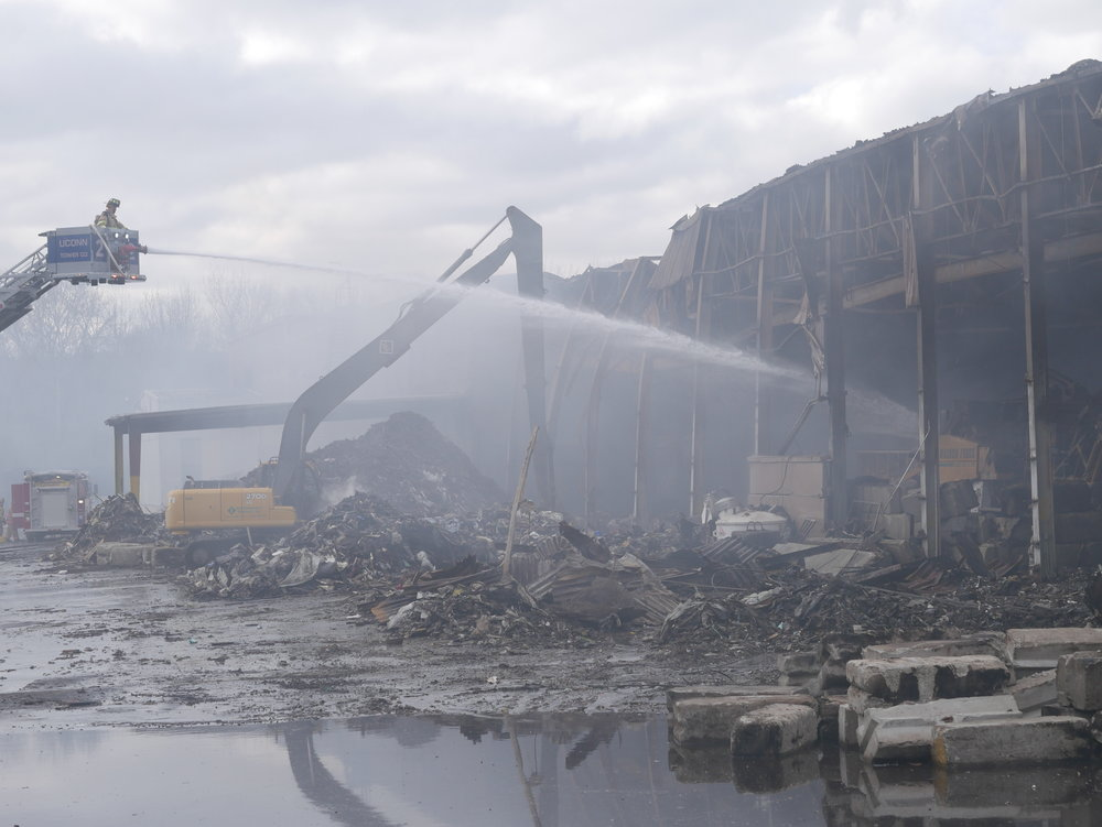 Fire departments from UConn and Willimantic along with other units work around the clock to prevent debris from the Willimantic waste company from reigniting. (Kobe Amos/The Daily Campus)