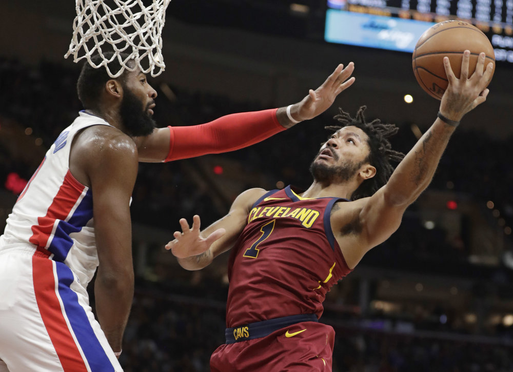 Cleveland Cavaliers' Derrick Rose, right, shoots against Detroit Pistons' Andre Drummond in the first half of an NBA basketball game, Sunday, Jan. 28, 2018, in Cleveland. (AP Photo/Tony Dejak)