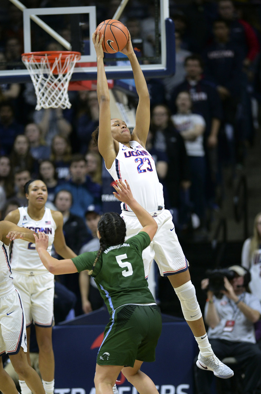 Azura Stevens (23) grabs a rebound over Tulane's Kayla Manuirirangi (5) in the second half of an NCAA college basketball game Saturday, Jan. 27, 2018, in Storrs, Conn. UConn won, 98-45. (Stephen Dunn/AP)
