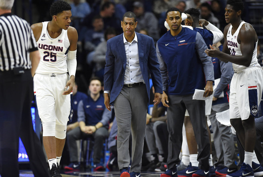 Connecticut head coach Kevin Ollie, center, walks up court during an NCAA college basketball game against SMU, Thursday, Jan. 25, 2018, in Storrs, Conn. The University of Connecticut confirms it is the target of an NCAA investigation into its men's basketball program. (AP Photo/Jessica Hill)