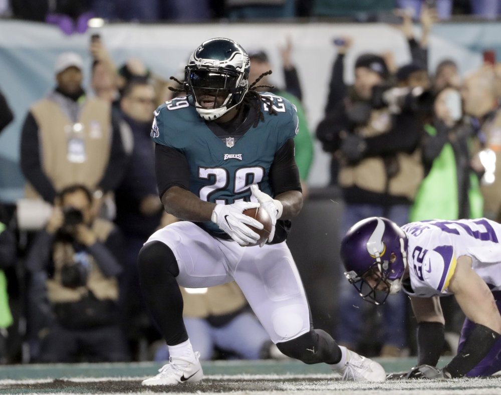 FILE - In this Sunday, Jan. 21, 2018, file photo, Philadelphia Eagles' LeGarrette Blount runs for a touchdown during the first half of the NFL football NFC championship game against the Minnesota Vikings in Philadelphia. The Eagles and the New England Patriots are set to meet in Super Bowl 52 on Sunday, Feb. 4, 2018, in Minneapolis. (AP Photo/Matt Slocum, File)
