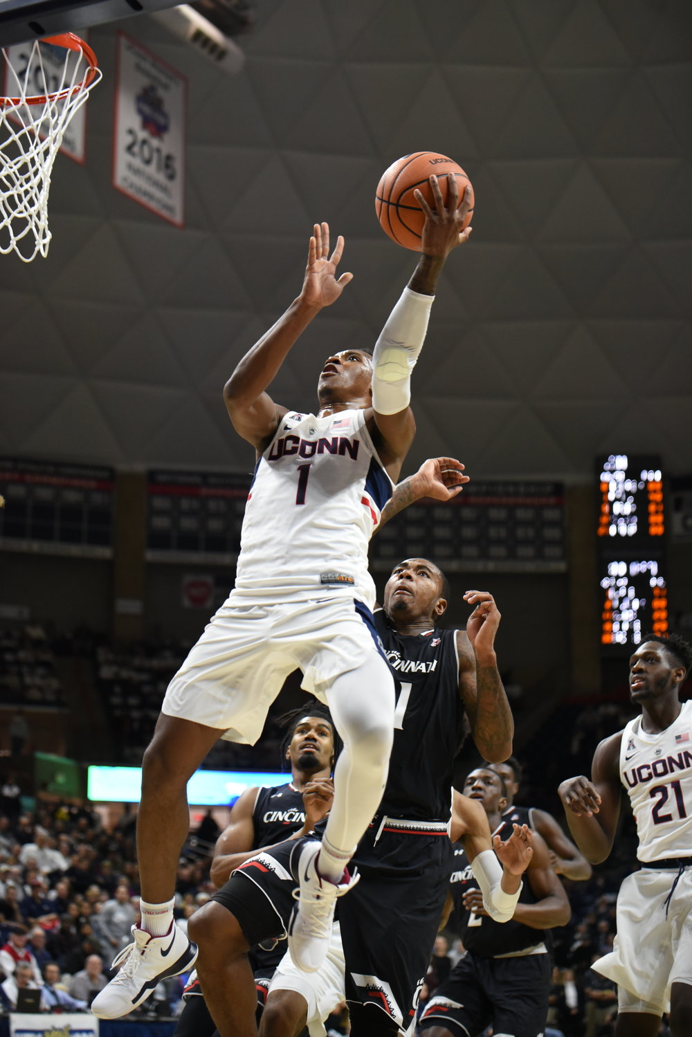 Christian Vital rises for a layup in Saturday's game. (Charlotte Lao/The Daily Campus)