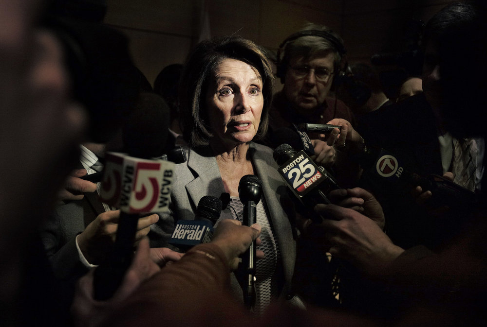 House Minority Leader Nancy Pelosi of Calif., takes questions from reporters following a town hall-style meeting. Pelosi spoke about the recently approved federal tax overhaul. (AP Photo/Steven Senne)