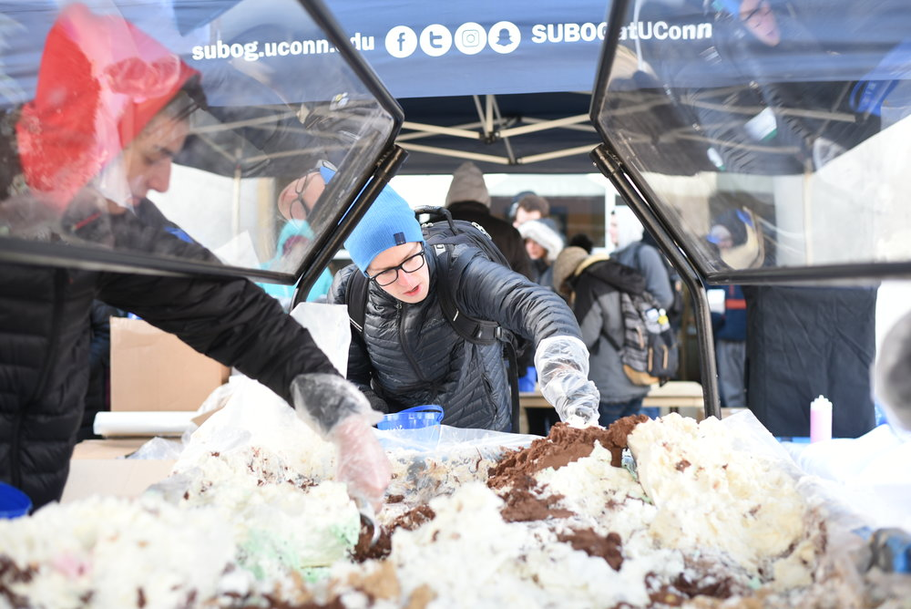 Students line up on the Student Union Patio for One Ton Sundae on Friday, February 2. SUBOG sponsored the event where students can fill bucket of Dairy Bar ice cream for $1. (Charlotte Lao/The Daily Campus)